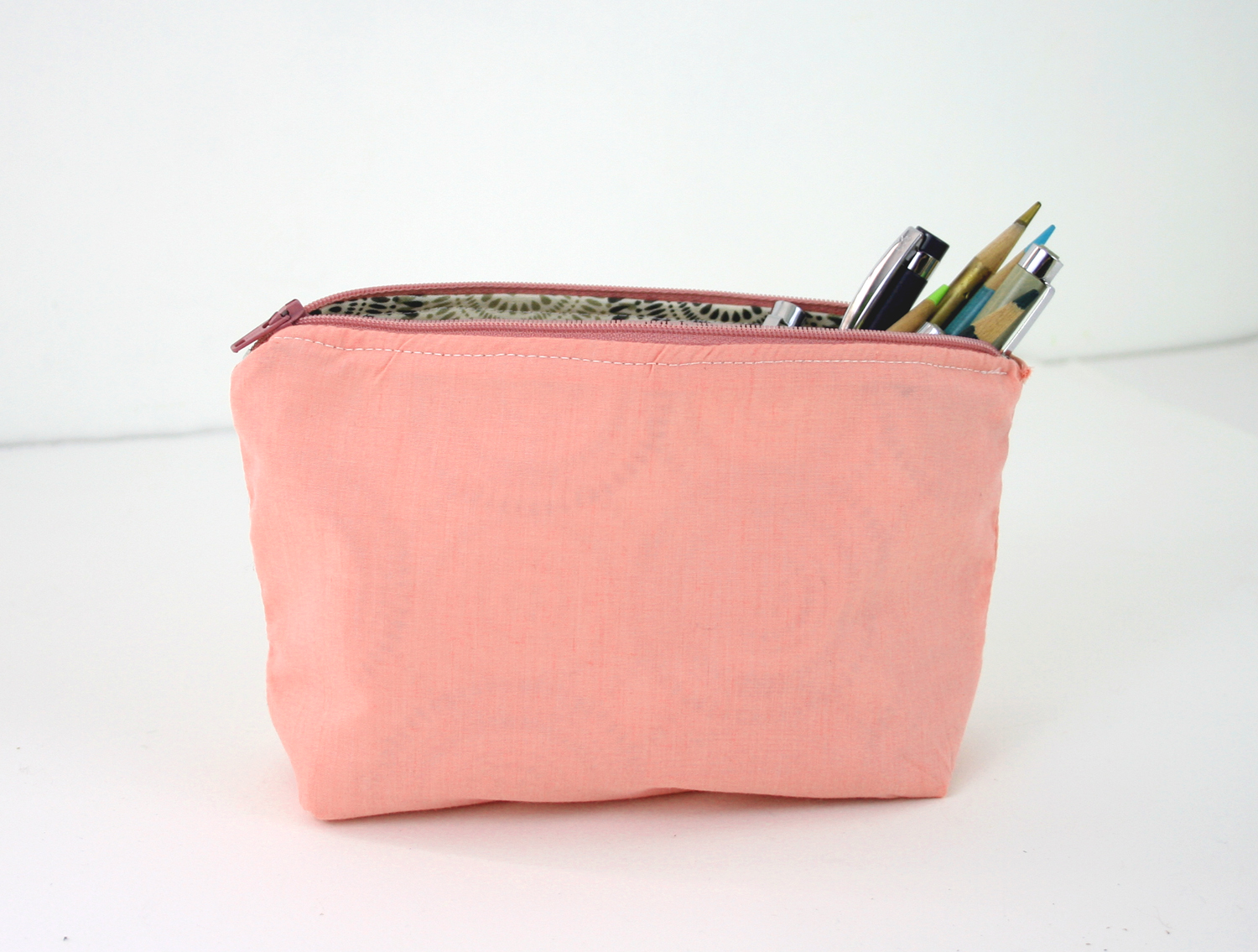 salmon and circles pouch