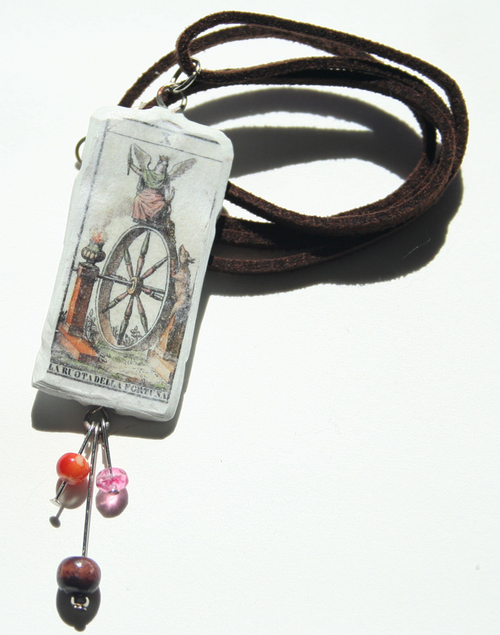wheel of fortune color with dangle on brown suede white
